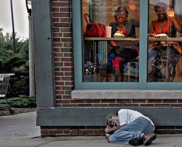 Ignorance_is_bliss__Homeless_man_sleeps_outside_a_diner_in_Milwaukee.jpg