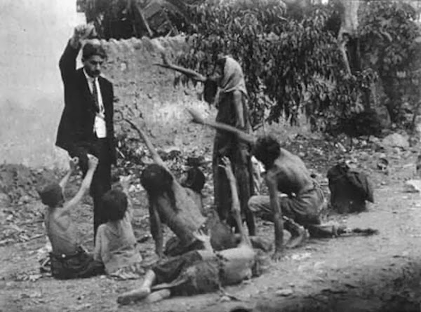 Turkish_official_teases_starving_Armenian_children_by_showing_them_a_piece_of_bread_during_the_Armenian_Genocide_in_1915.jpg
