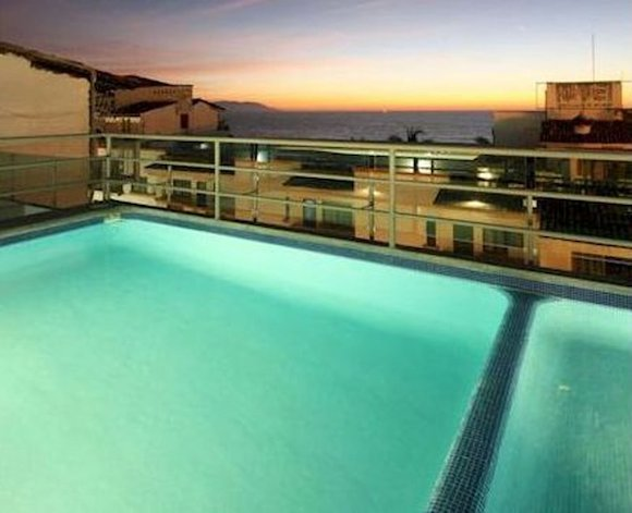 fantasy-wed-love-to-take-a-dip-in-the-rooftop-pool-at-hotel-portonovo-in-puerto-vallarta.jpg